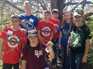 Students with OwlBTravelin', a trackable we will hopefully watch travel the world via Geocaching!